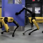 Two Boston Dynamics robots cooperate to open a door in an autonomous manner